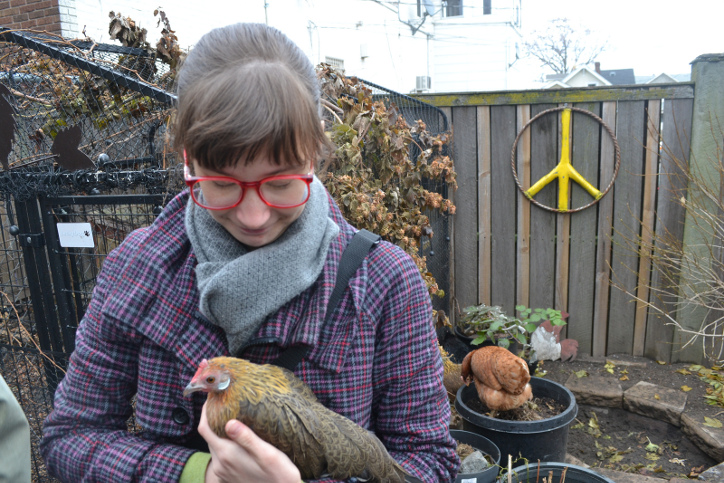 Kealy Holds a Hen at Chicken Run Rescue