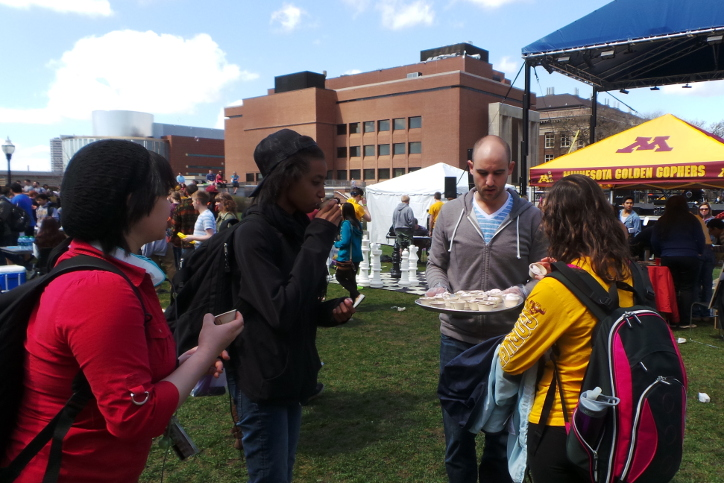 Handing out vegan food samples at the 2014 UMN Spring Jam